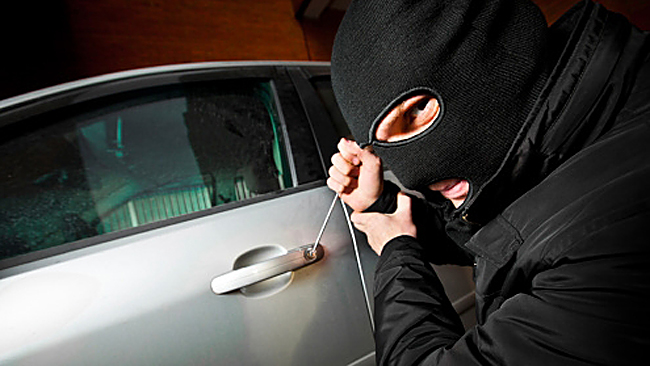 burglar-robbing-car-kept-safe-with-insurance-for-young-driver-from-coverinaclick.ie