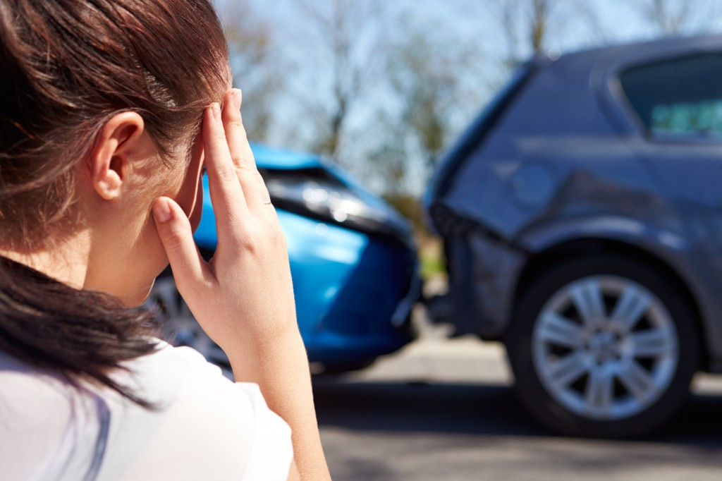 young-female-driver-crash-car-insurance-premium-coverinaclick.ie
