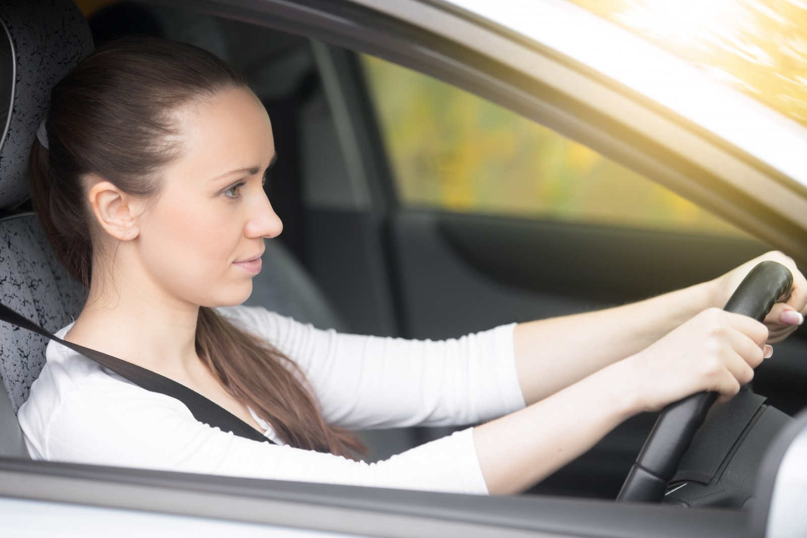 young-female-driver-drive-safely-happy-car-insurance-coverinaclick.ie