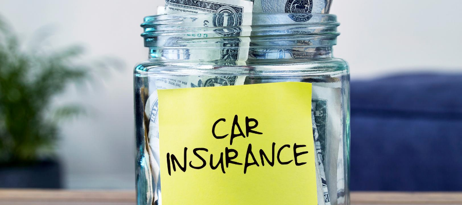 Money in a jar labelled car insurance